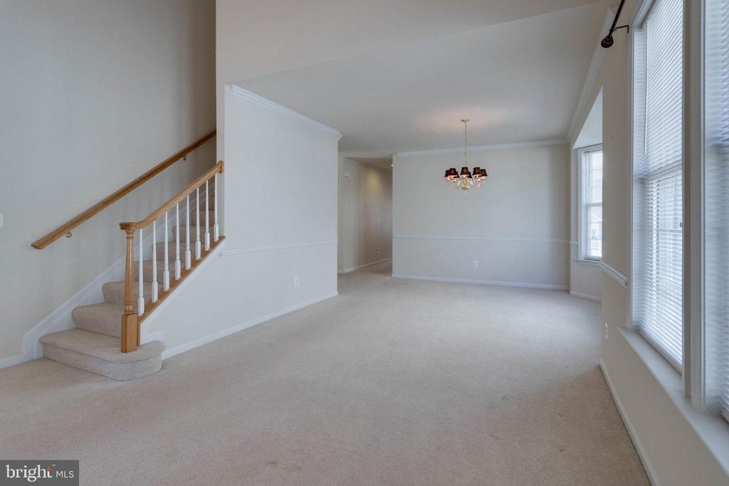 Stairs lead the way to upper level - 6136 FERRIER CT, GAINESVILLE