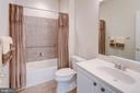 Hallway bath with neutral ceramic tile - 6136 FERRIER CT, GAINESVILLE