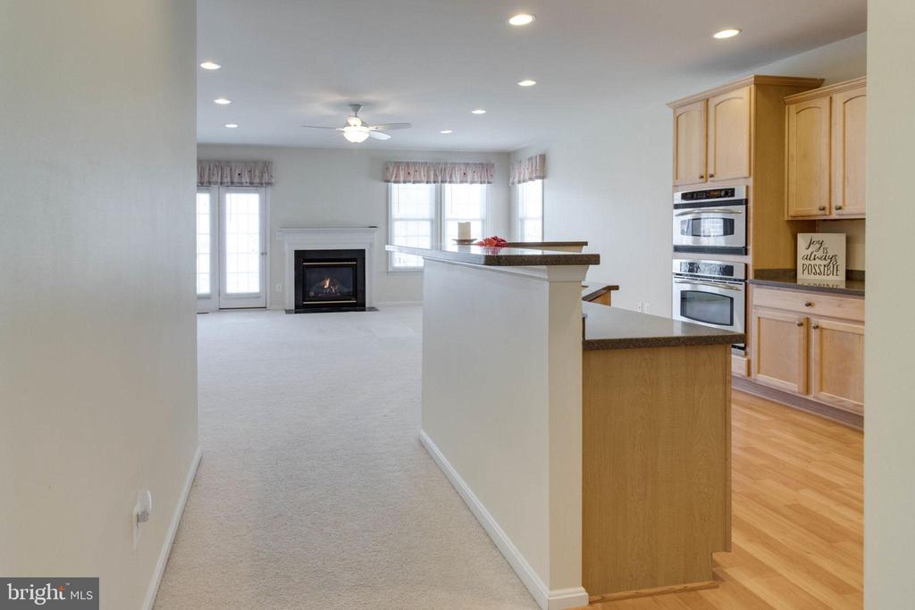 Kitchen opens to family room with gas fireplace - 6136 FERRIER CT, GAINESVILLE