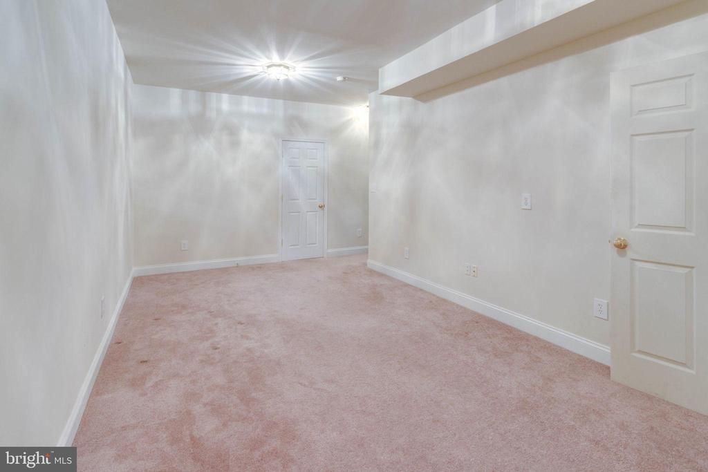 Lower level room at bottom of stairs - 6136 FERRIER CT, GAINESVILLE