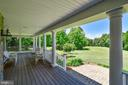 Relax on the  inviting front porch - 38961 SHIRE MEADOW LN, HAMILTON
