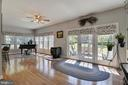 The sunroom opens to a paver patio and fire pit - 38961 SHIRE MEADOW LN, HAMILTON