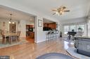 The  sun room opens to the kitchen and family room - 38961 SHIRE MEADOW LN, HAMILTON