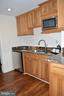 Kitchenette in lower level - 20440 SWAN CREEK CT, STERLING