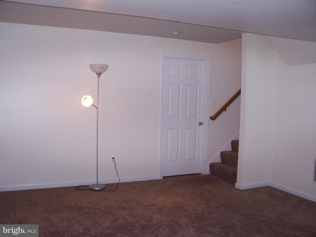 Family Room- Door to Laundry & Storage - 10012 GRASS MARKET CT, FREDERICKSBURG