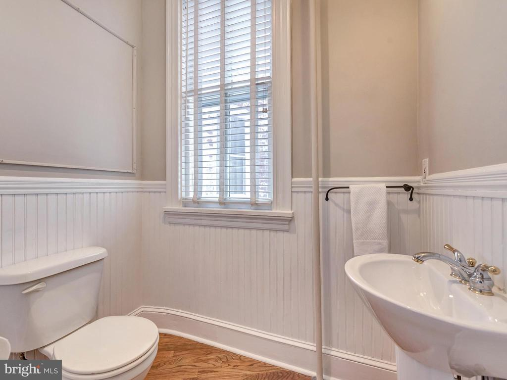 Half bath on the main level. - 30 E 3RD ST E, FREDERICK