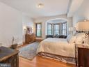 Large master bedroom with window seating area. - 30 E 3RD ST E, FREDERICK