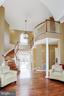 Two story foyer with a circular floating staircase - 13300 IVAKOTA FARM RD, CLIFTON