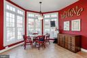 Large eat-in kitchen filled with light. - 13300 IVAKOTA FARM RD, CLIFTON