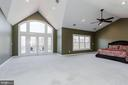 The owners suite, a sanctuary of light and design. - 13300 IVAKOTA FARM RD, CLIFTON