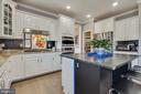 Open Kitchen with Pass Through to Dining Room - 41957 DONNINGTON PL, ASHBURN