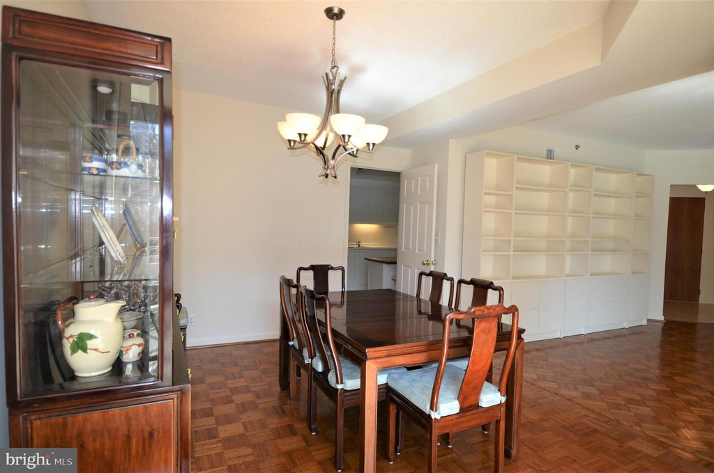 Dining room into kitchen and living room - 5610 WISCONSIN AVE #406, CHEVY CHASE