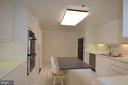 Kitchen with breakfast bar/island - 5610 WISCONSIN AVE #406, CHEVY CHASE