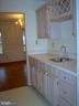 Wet bar/pantry between kitchen & Dining Room - 5105 QUEENSBURY CIR, FREDERICKSBURG