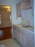 Wet bar/pantry between kitchen & Dining Room - 5105 QUEENSBURY CIR, FREDERICKSBURG