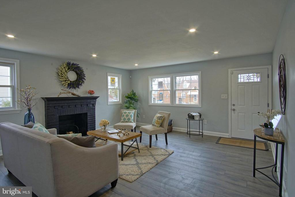 Living room with wide plank laminate floors - 6511 ADAK ST, CAPITOL HEIGHTS