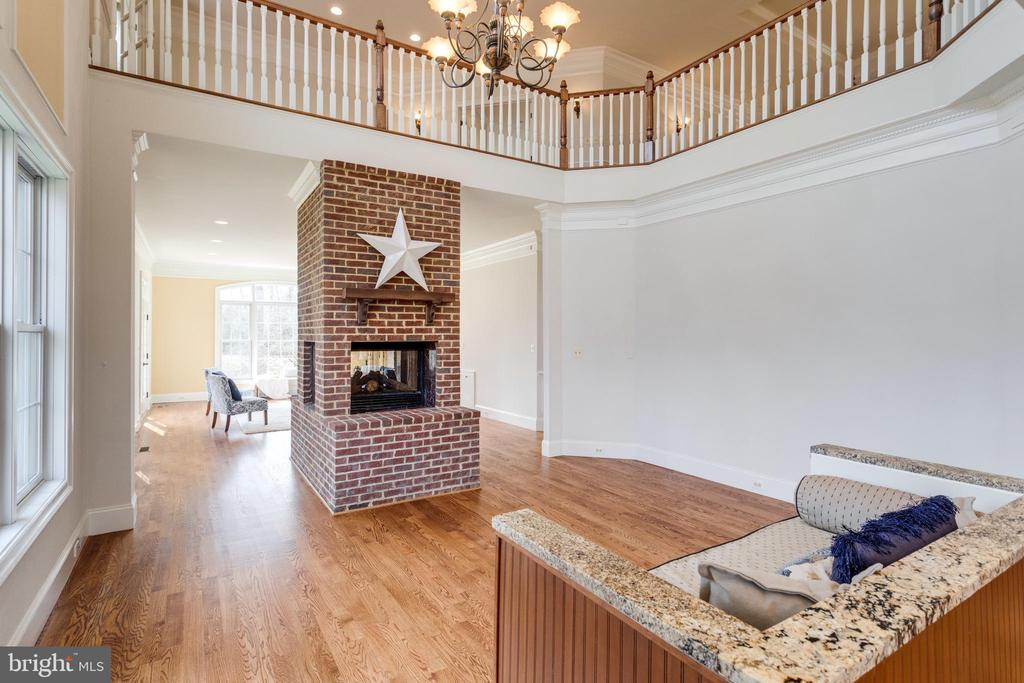 The two-story eat-in area allows tons of light! - 1847 HUNTER MILL RD, VIENNA