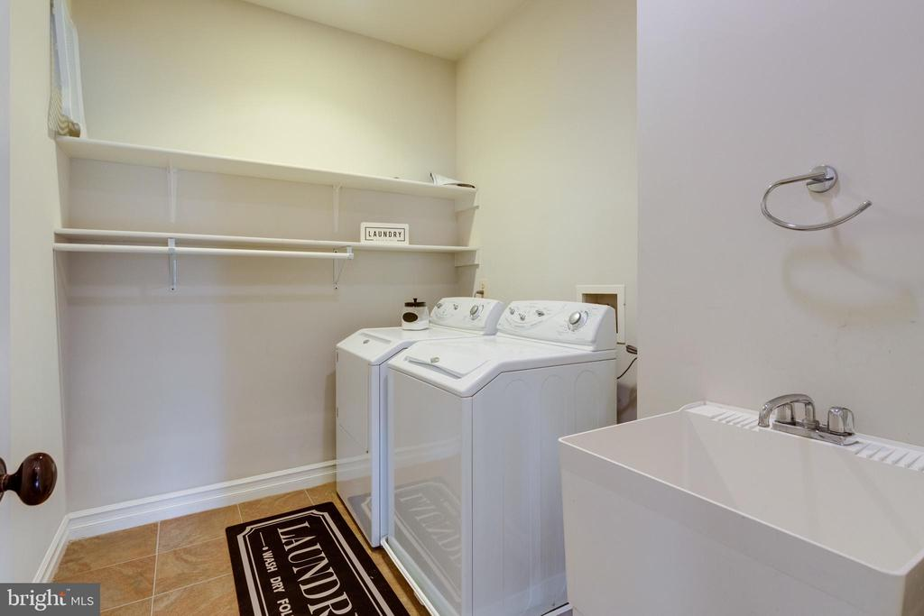 Upper-level laundry room with utility tub - 1847 HUNTER MILL RD, VIENNA