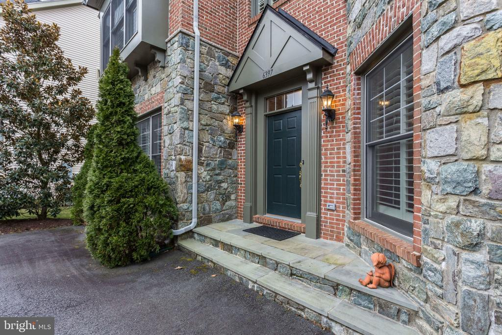 Inviting entrance with stone and brick exterior. - 6397 GAYFIELDS RD, ALEXANDRIA
