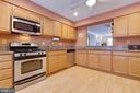 Large Kitchen with Granite Counter Top - 9087 GOLDEN SUNSET LN, SPRINGFIELD
