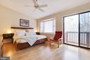 En Suite Master Bedroom with Balcony - 9087 GOLDEN SUNSET LN, SPRINGFIELD