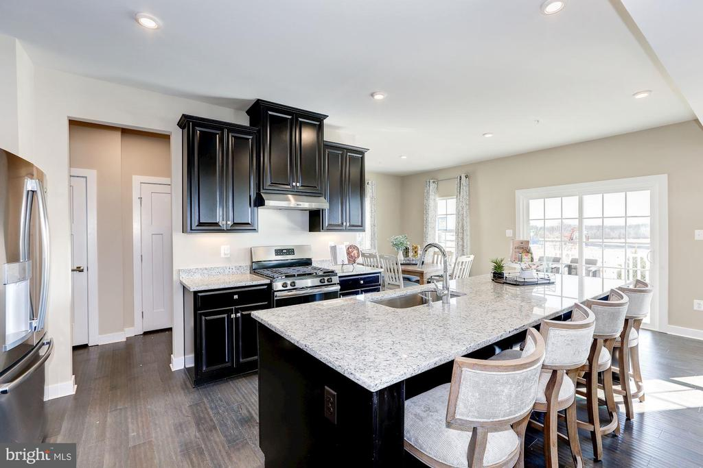 kitchen with huge island - 5323 STRIPED MAPLE ST, FREDERICK