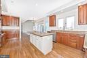 Kitchen- Center Island with Prep Sink - 5580 BROADMOOR TER N, IJAMSVILLE