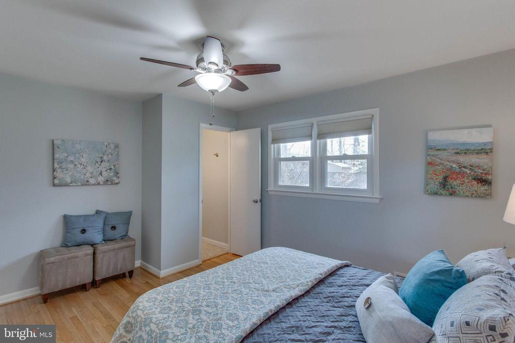The master bedroom looks out to the sunny yard - 6808 HACKBERRY ST, SPRINGFIELD
