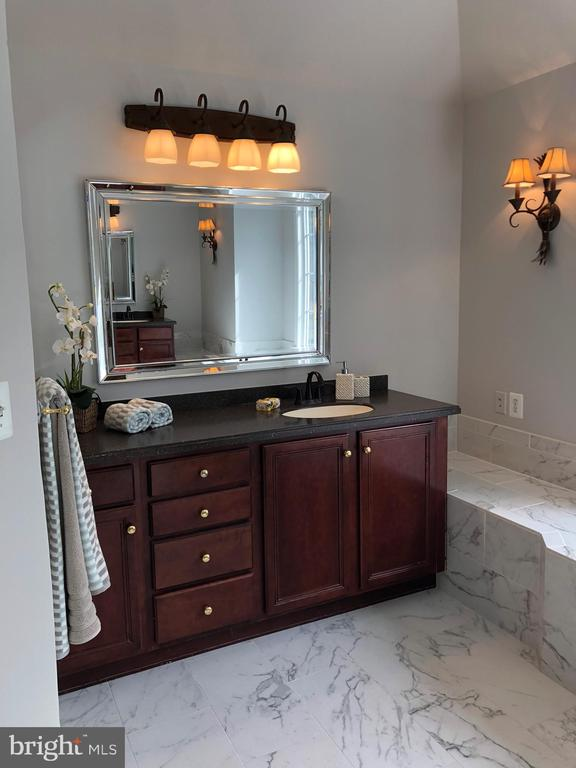 Updated master bath with his and her vanities. - 1211 RESTON AVE, HERNDON