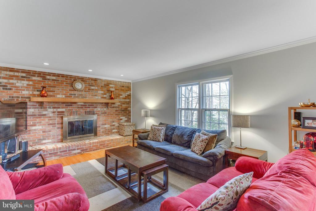 Family Room with brick fireplace wall - 4800 JENNICHELLE CT, FAIRFAX