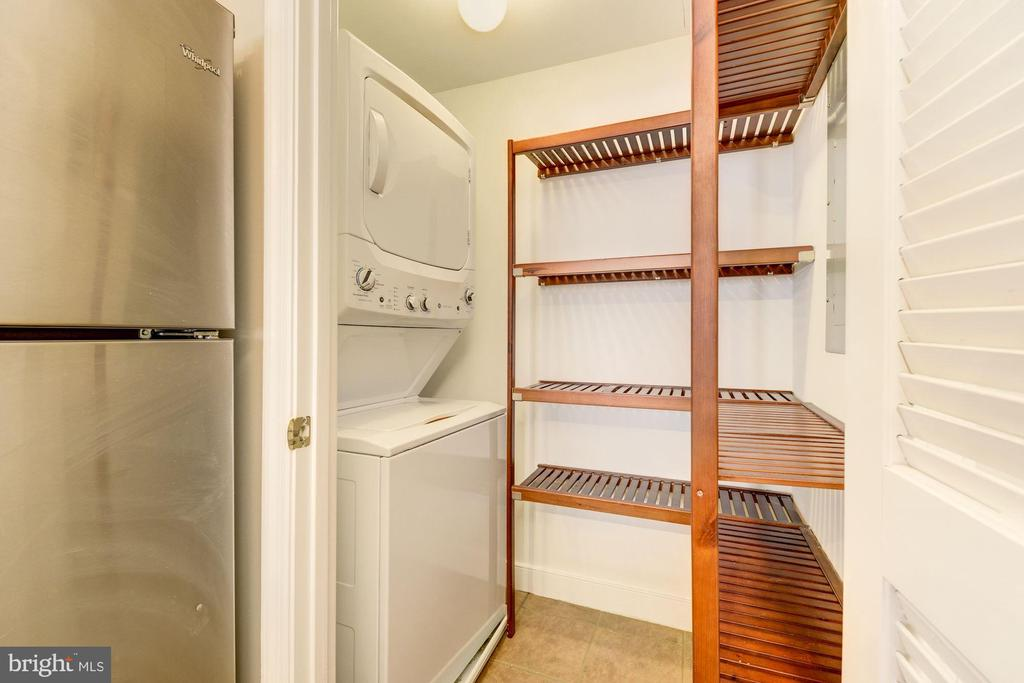 Large pantry with stacked laundry. - 616 E ST NW #822, WASHINGTON