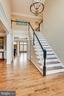 Entry highlights hardwood floors - 11580 CEDAR CHASE RD, HERNDON