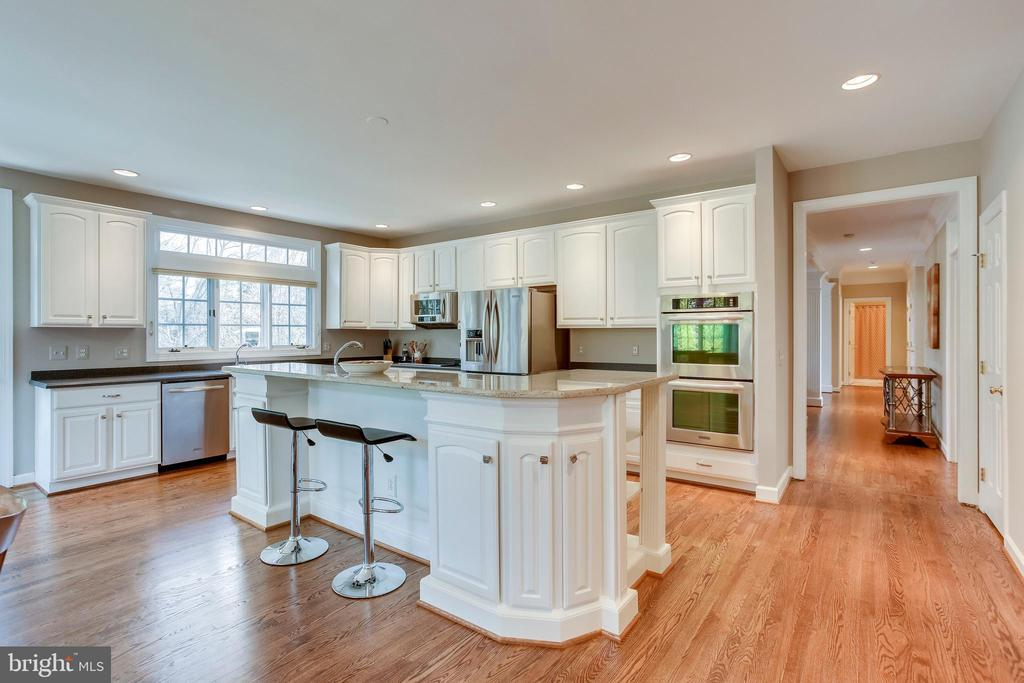 Kitchen is located off family and dining rooms - 11580 CEDAR CHASE RD, HERNDON