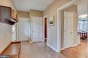 Mud Room to kitchen, half bath, and garage - 11580 CEDAR CHASE RD, HERNDON
