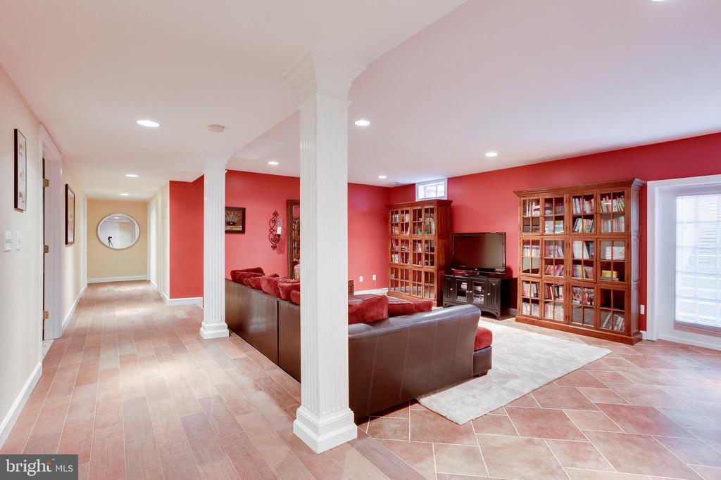 Family room and hall to full bath and bedroom - 11580 CEDAR CHASE RD, HERNDON
