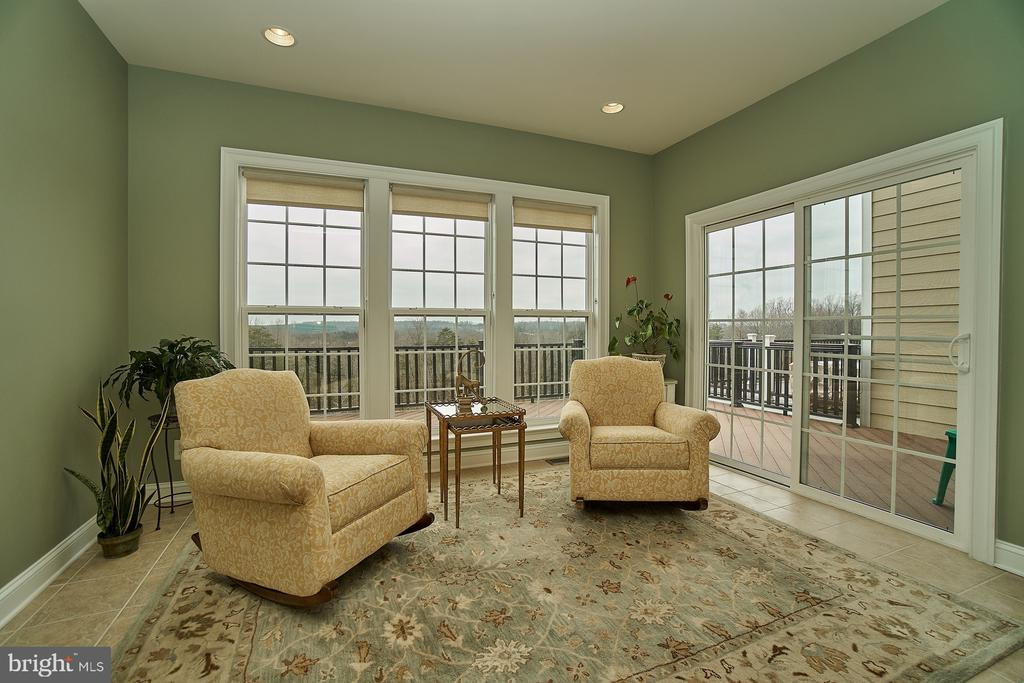 Sun room with ceramic flooring and door to deck - 20639 ERSKINE TER, ASHBURN