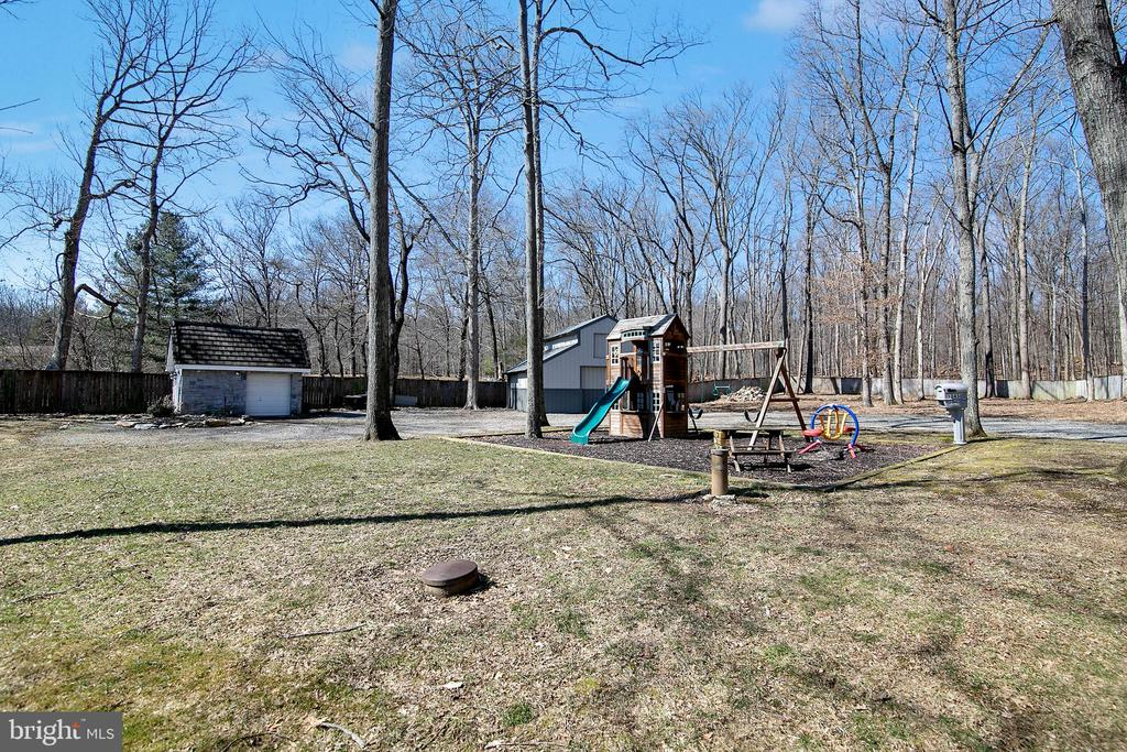 PLAY AREA AND VIEW TO BARN AND MOWER GARAGE - 13450 REED RD, THURMONT
