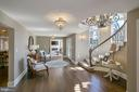 ELEGANT 26 FOOT FOYER WITH CURVED STAIRCASE - 13450 REED RD, THURMONT