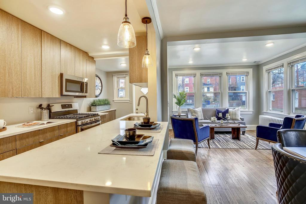 Deep kitchen counter with seating. - 4314 13TH PL NE, WASHINGTON