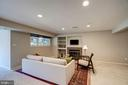 Lower level rec room with fireplace - 1466 WATERFRONT RD, RESTON