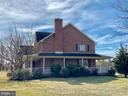 Right side showing wrap around covered porch. - 555 QUAINT SWAN DALE DR, MARTINSBURG