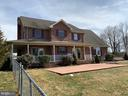 This is the back of home w/stamped concrete patio. - 555 QUAINT SWAN DALE DR, MARTINSBURG