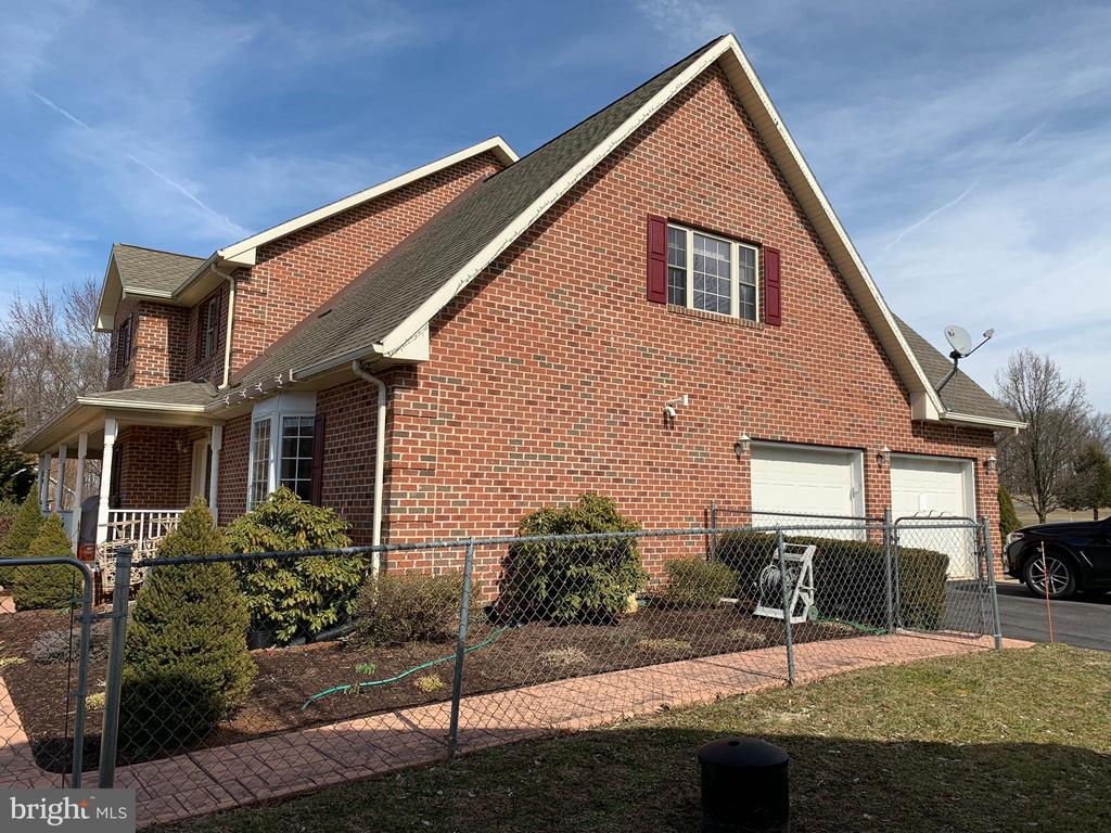 Left side of  home showing attached 2 car garage - 555 QUAINT SWAN DALE DR, MARTINSBURG