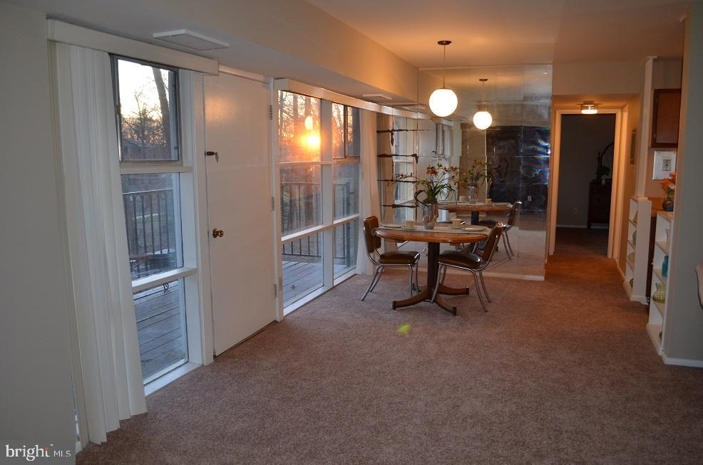 On left is door to balcony, dining / living area - 4917 AMERICANA DR #E, ANNANDALE