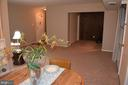 From dining area looking into Den and Living Room - 4917 AMERICANA DR #E, ANNANDALE