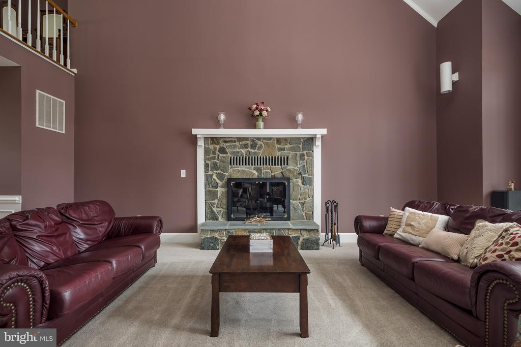 Family room with stone fireplace - 4551 SUNSHINE CT, WOODBRIDGE