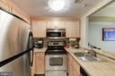 Stainless appliances + granite counters in kitchen - 1150 K ST NW #309, WASHINGTON
