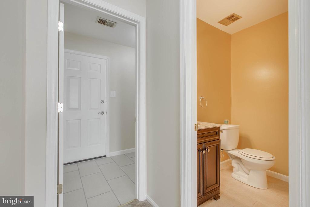 hallway leading to half bath and laundry - 14513 CARONA DR, SILVER SPRING