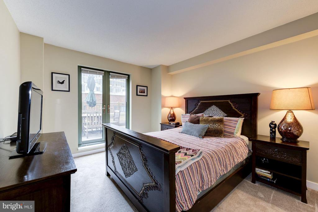 Primary bedroom with rare private patio. - 1150 K ST NW #309, WASHINGTON