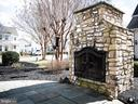 Patio with outdoor fireplace. - 21883 KNOB HILL PL, ASHBURN